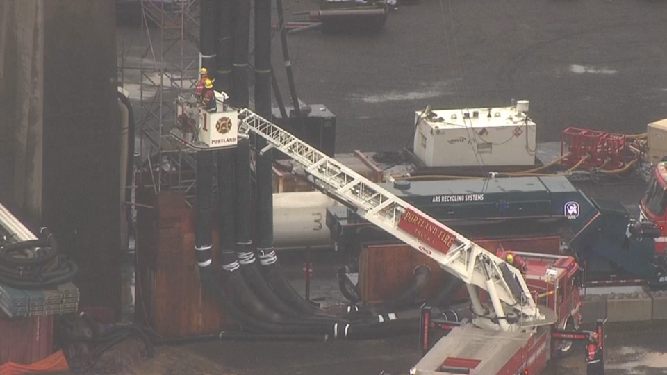 AIR 12 image of firefighters attempting rope rescue