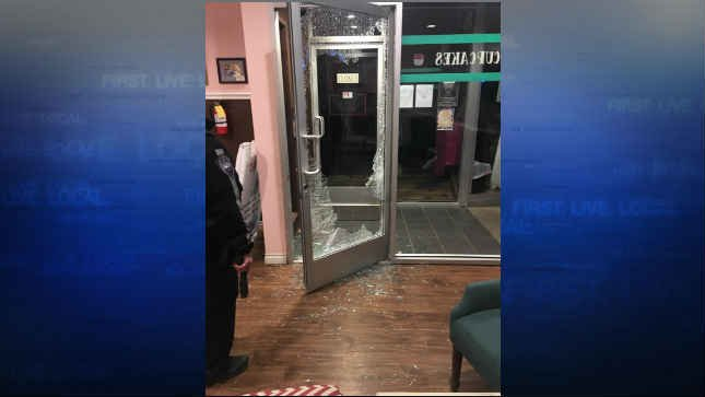 The door was shattered at Cake Happy in downtown Camas early Monday morning. (KPTV)