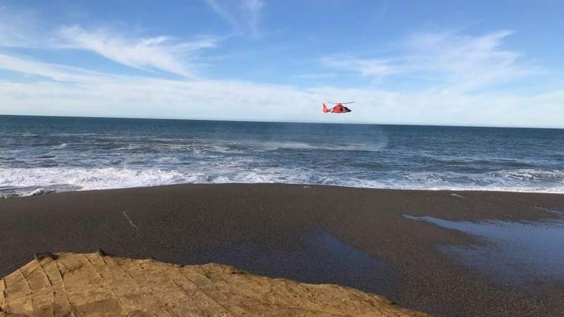 U.S. Coast Guard photo of January search for man and son washed out to sea on southern Oregon coast.