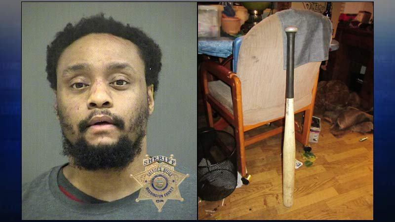 Jail booking photo of Darnell J. Labossiere and baseball bat used in menacing incident (Photos: Washington County Sheriff's Office)