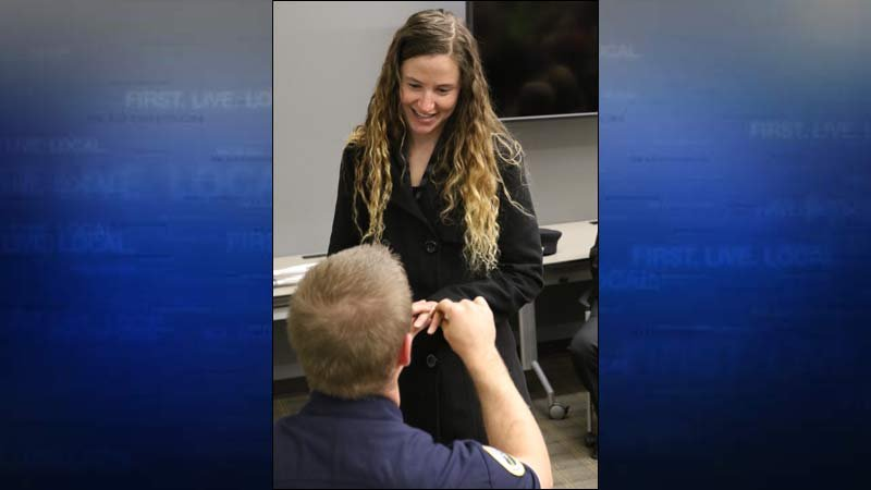 Taylor Mehringer proposed to Amanda Gisler after receiving his badge as a new firefighter at the Hillsboro Fire Department. (Photo: Hillsboro Fire Department)
