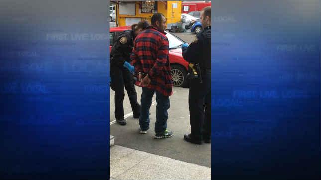 Uriel Lazaro-Ixtlahuaco being arrested in downtown Portland Thursday. (KPTV)