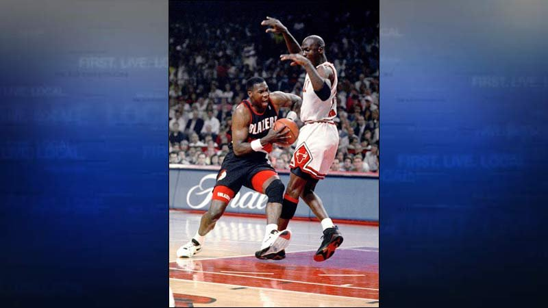 Michael Jordan tries to hold off Jerome Kersey during first quarter of Game 6 in the NBA Finals in Chicago, Sunday, June 14, 1992. (AP Photo/Fred Jewell)