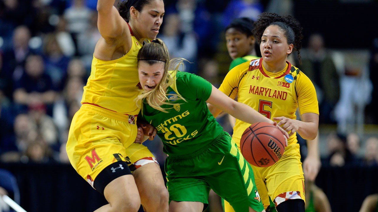 Oregon's Sabrina Ionescu tries to drive against Maryland's Brionna Jones, left, during the second half of a regional semifinal game in the NCAA women's college basketball tournament, Saturday, March 25, 2017, in Bridgeport, Conn. (AP Photo/Jessica Hill)