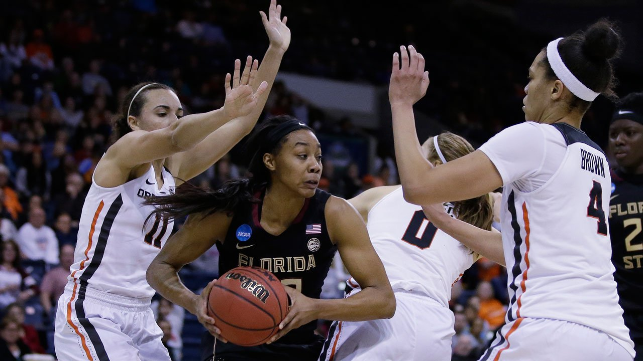 FSU forward Ivey Slaughter is triple- teamed by OSU's Gabriella Hanson, Mikayla Pivec and Breanna Brown during the second half of a regional semi-final round game of an NCAA college basketball tournament in Stockton, Calif. (AP Photo/Rich Pedroncelli)
