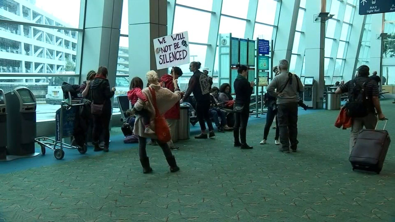 Protesters at Portland International Airport on Wednesday (KPTV)