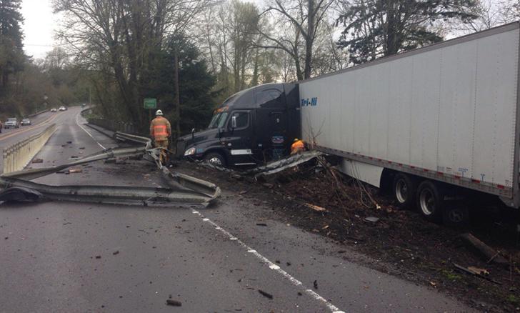 Semi truck crashes into guard rail along hwy e near
