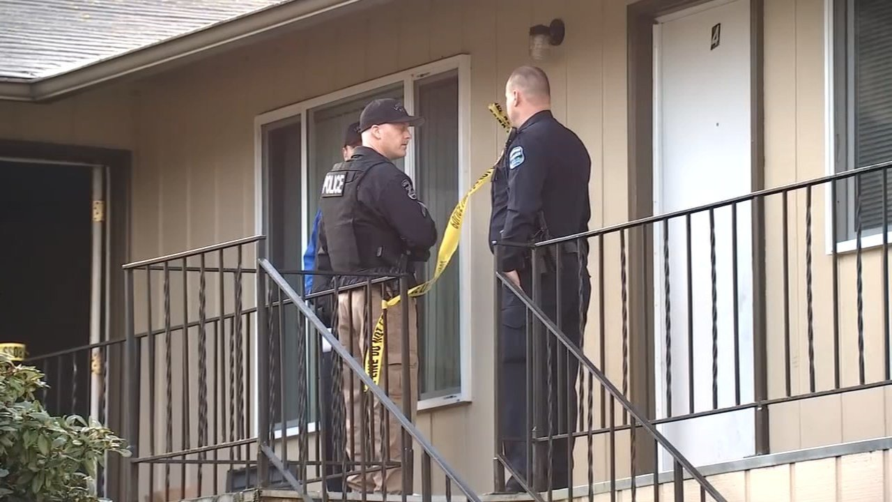 Police at the scene of a murder-suicide involving a father and his young son in Longview. (KPTV)