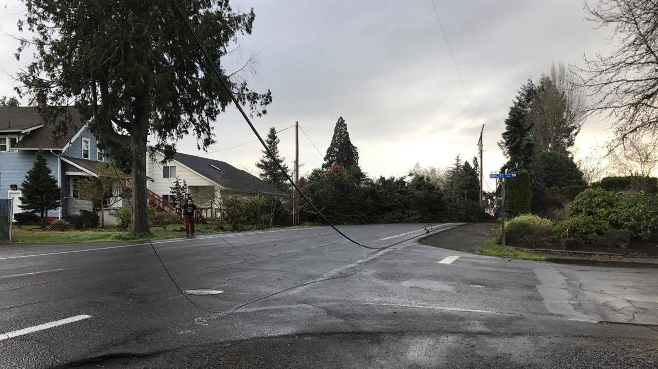 Facebook user Holly Creekmore shared this photo of a power line knocked down during the wind storms Friday morning, one of many affecting more than 100,000 utility customers in the area. (courtesy Holly Creekmore)