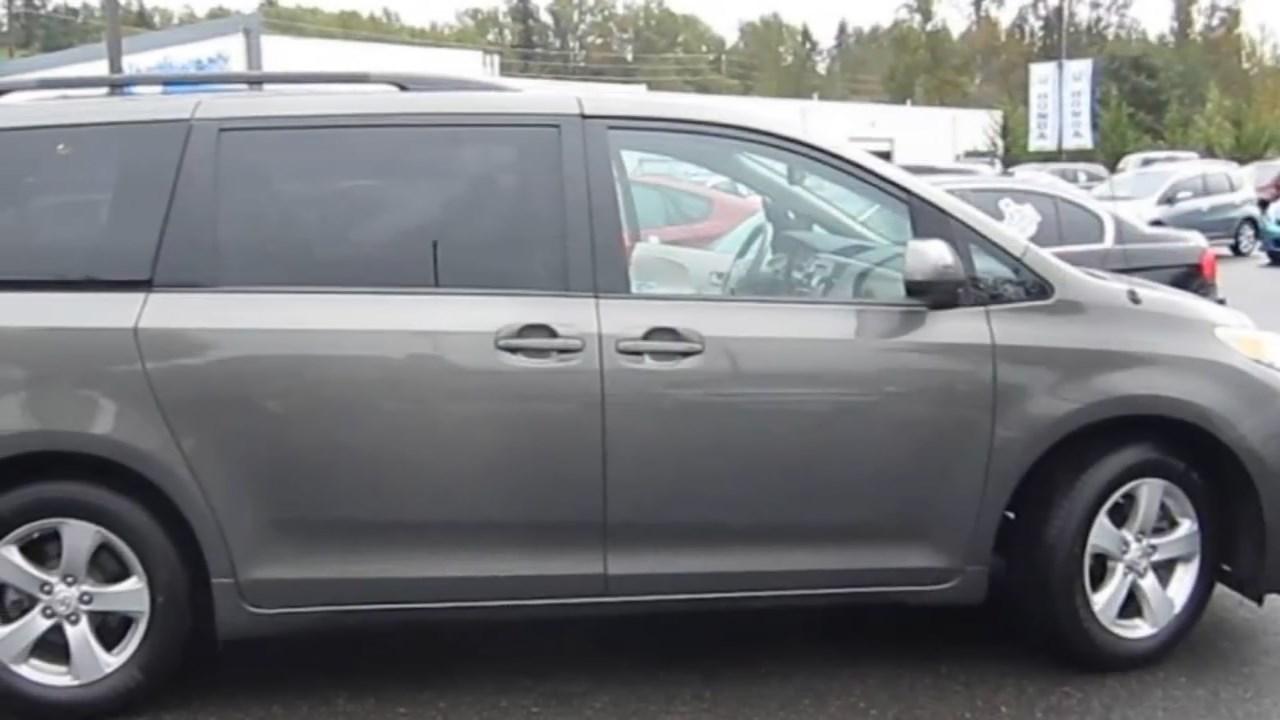 Dark grey Toyota Sienna (Family photo)