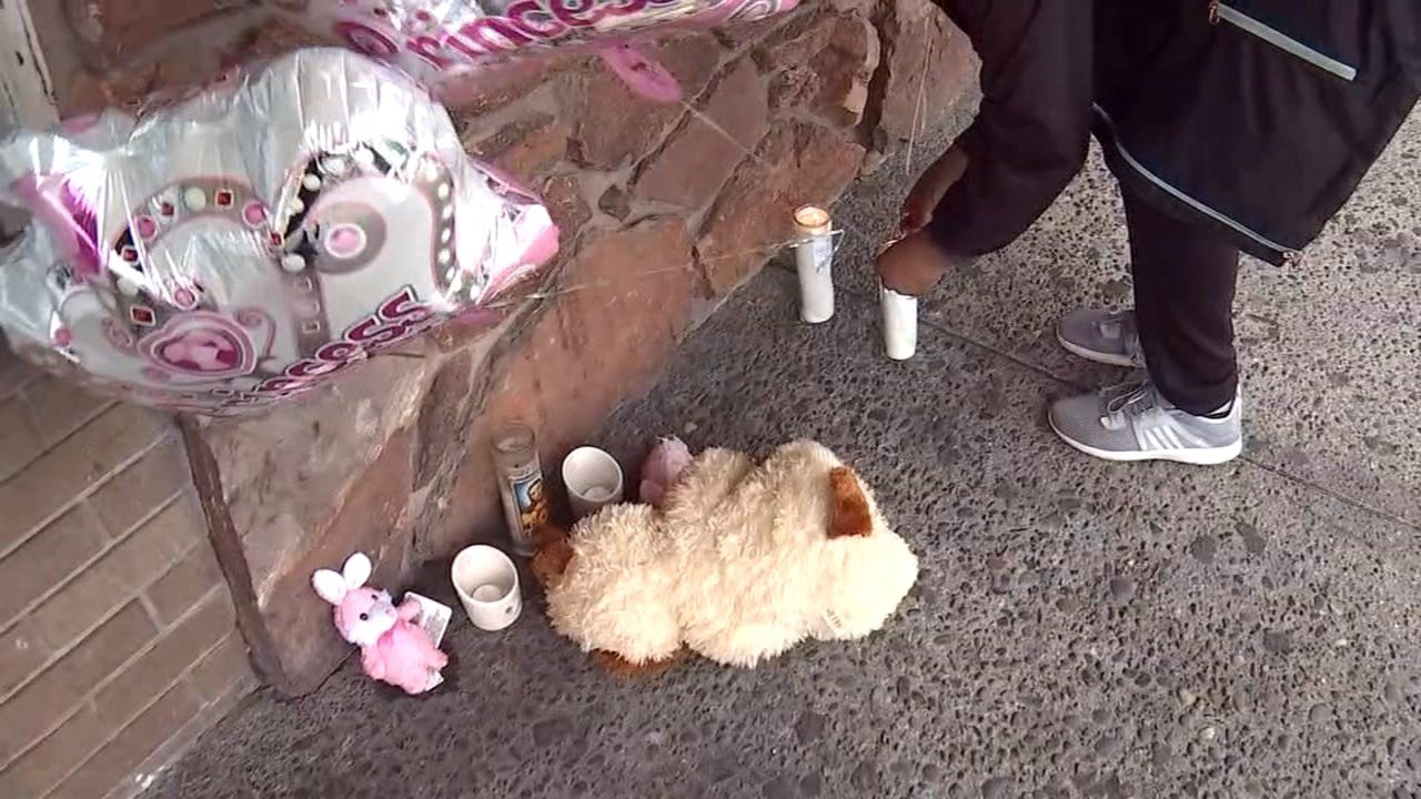 Memorial for girls killed in Gresham area by their father. (KPTV)