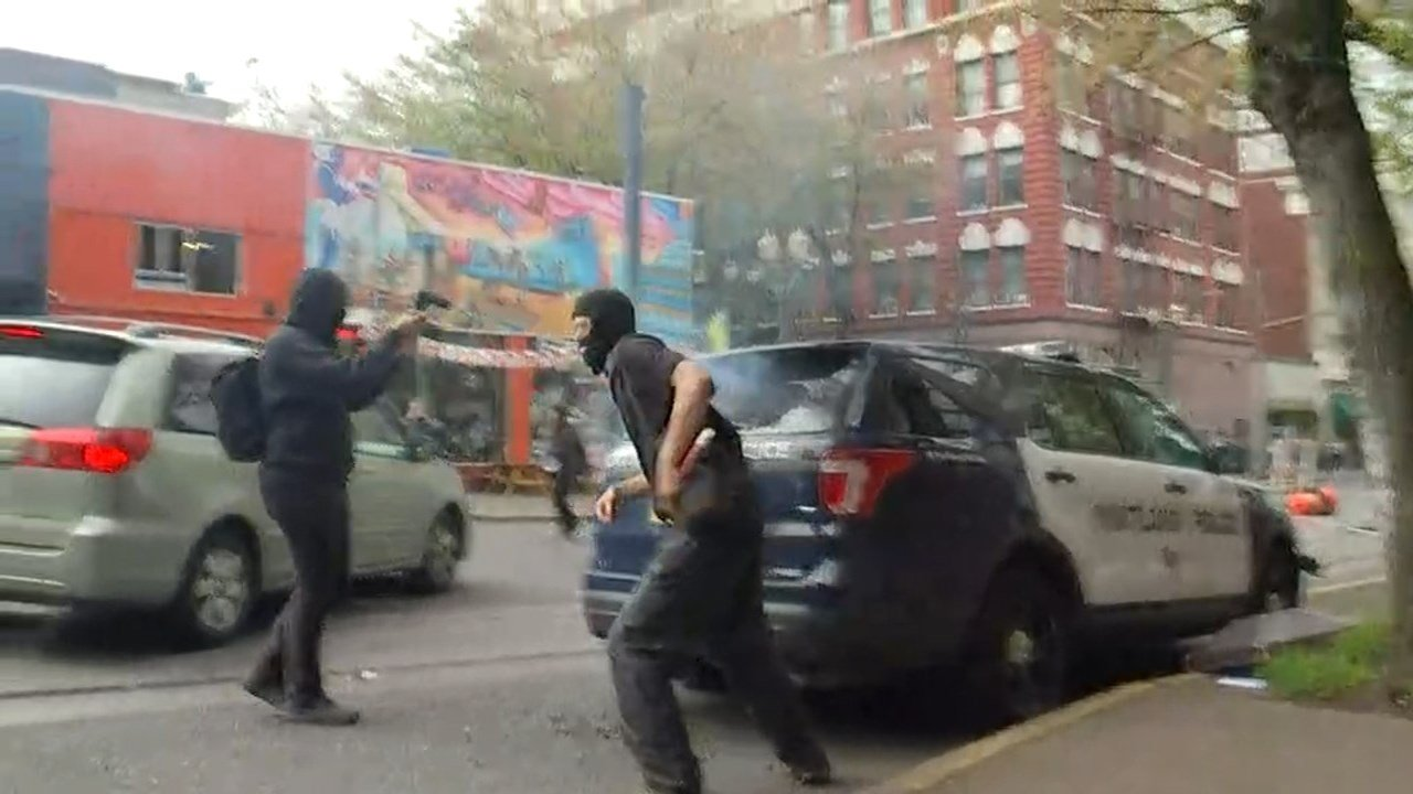 A patrol car was set on fire with a road flare during the May Day riot. (KPTV)