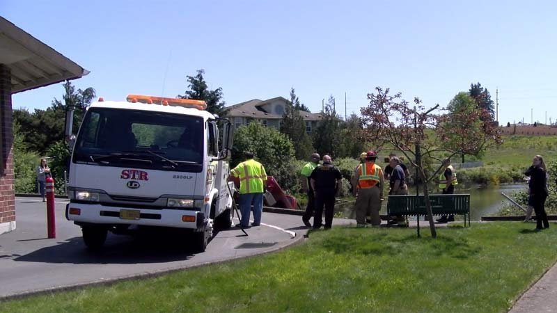 Two people in the truck were rescued and not injured. (KPTV)