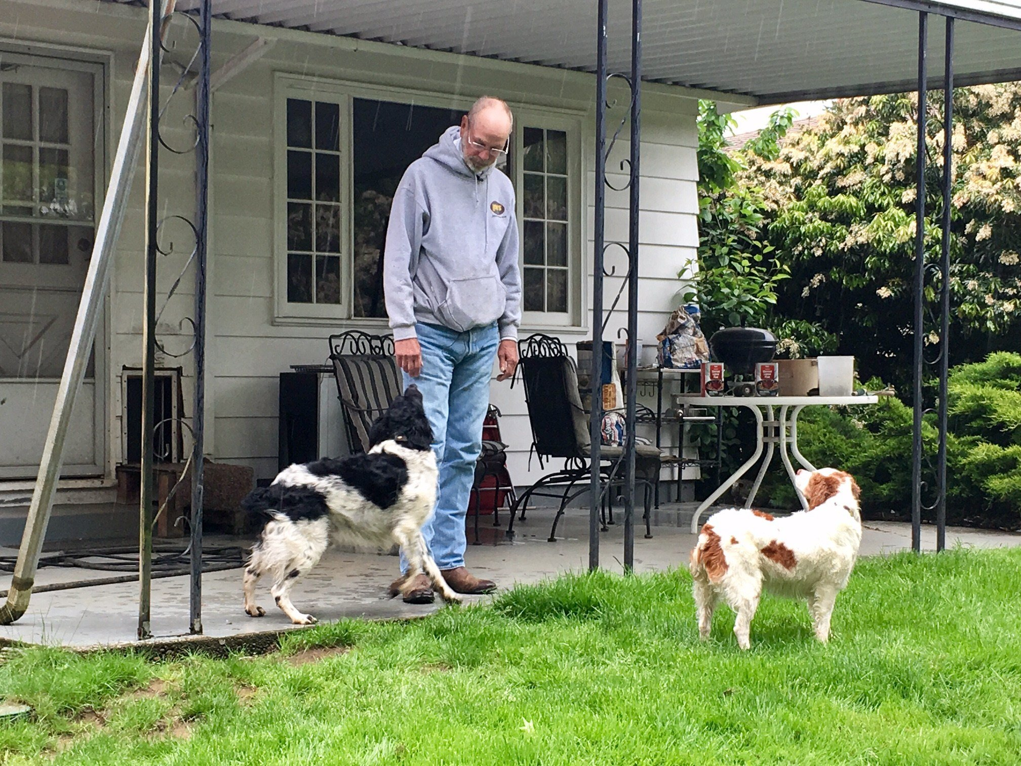 Richard Schmidtke and his two dogs, Bandit and Snowflake Thursday.