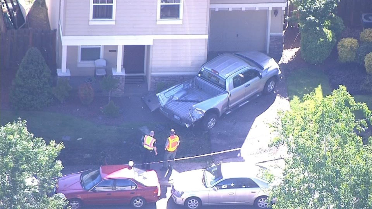 Truck that was hit by a landscaping truck in Canby (KPTV/Air 12)