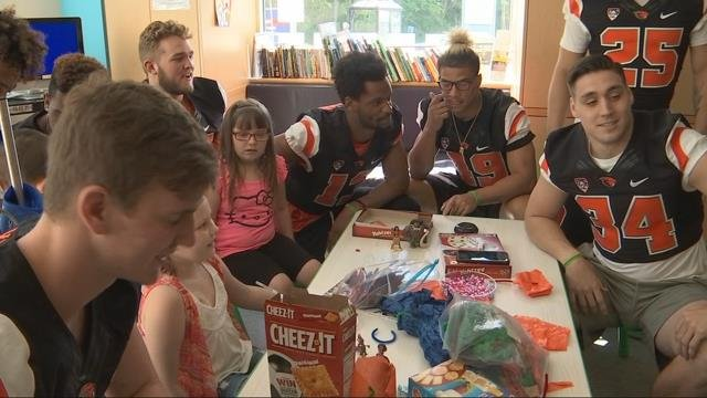 Beaver football players 'Let It Go' at Doernbecher Children's Hospital