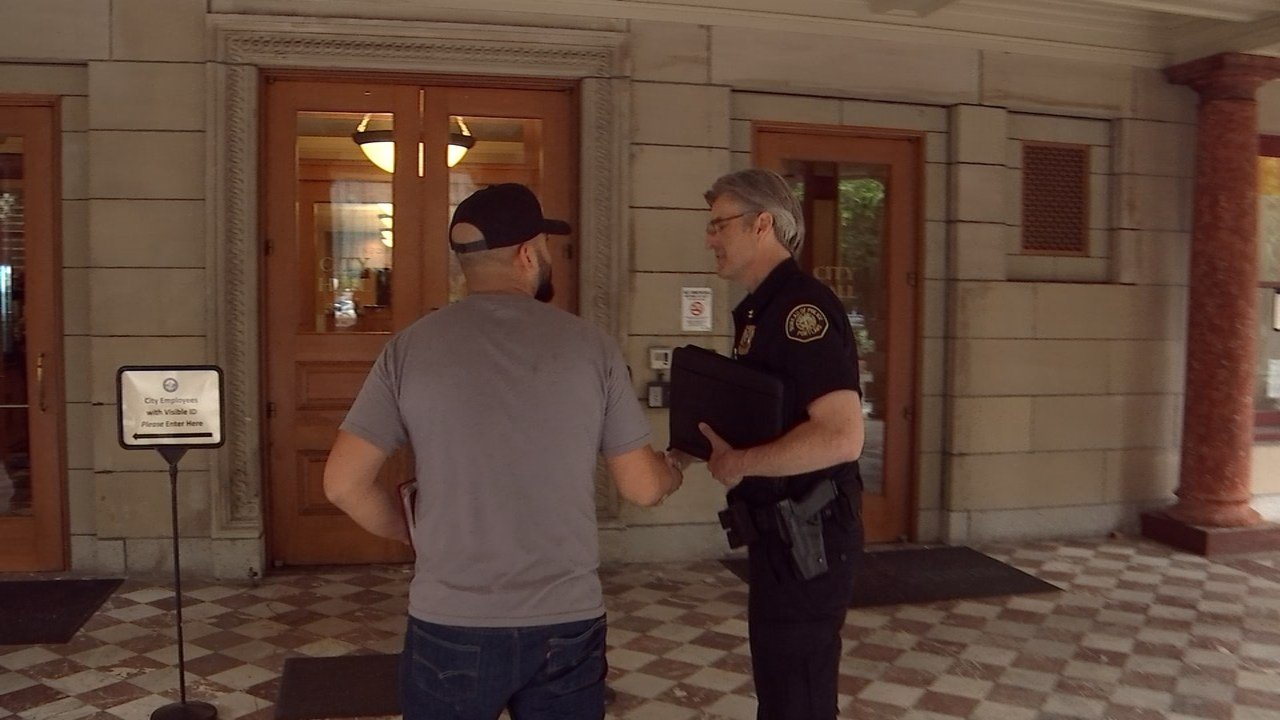 Police Chief Mike Marshman greeting rally organizer Joey Gibson at City Hall on Tuesday. (KPTV)
