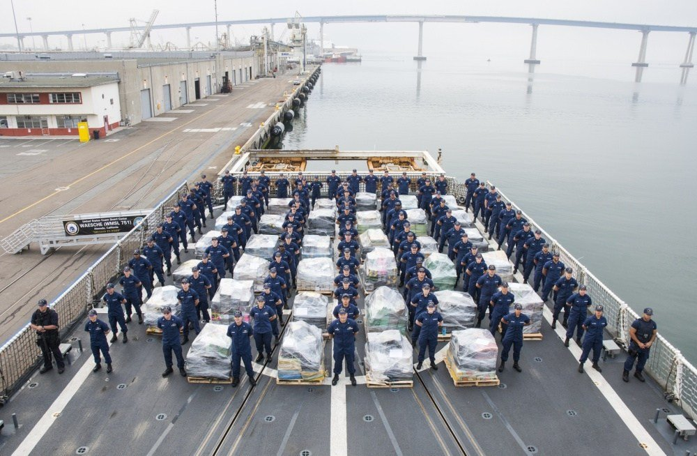 The crew of the Coast Guard Cutter Waesche, homported in Alameda, California, forms along side approximately 18 tons of cocaine at 10th Ave Marine Terminal in San Diego on June 15, 2017. (Photo: US Coast Guard)