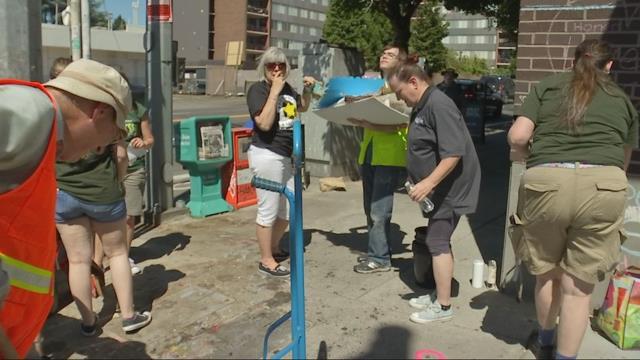 Volunteers clean memorial to MAX train stabbing victims