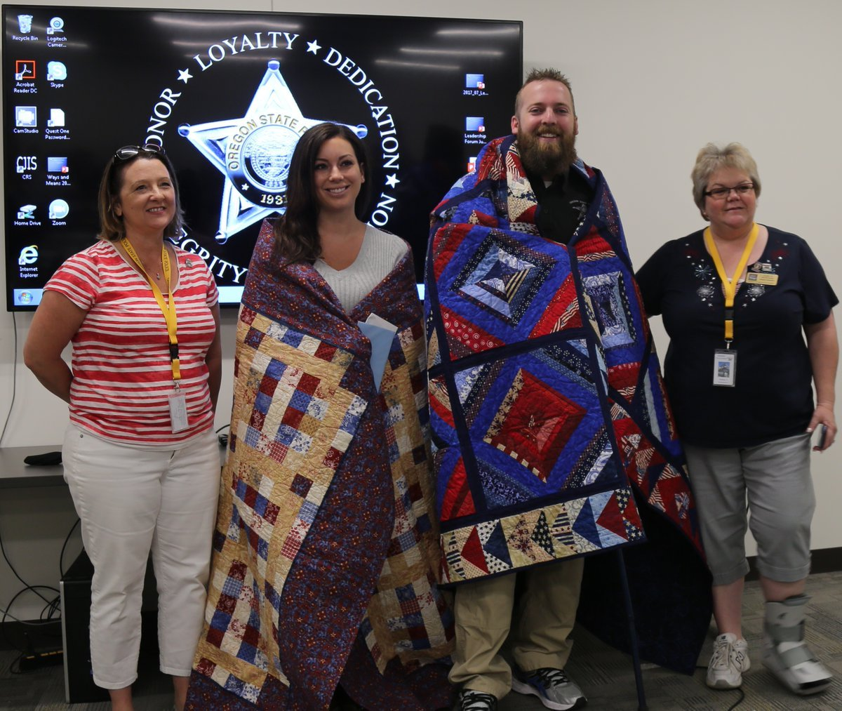 Trooper Nic Cederberg and his wife, PPB officer Hayley Shelton, awarded Quilts of Valor (Courtesy: Oregon State Police)