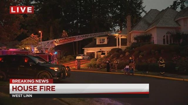 Crews battle house fire in West Linn