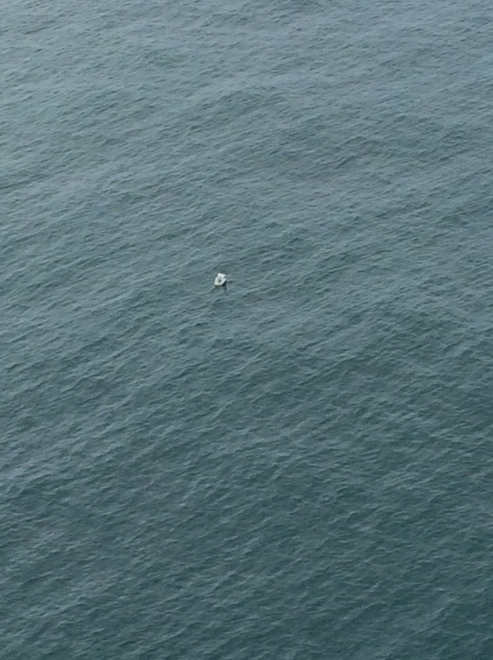 Debris from the 45-foot pleasure yacht Sea Crest is spotted on the water the morning after the vessel collided with an unknown object and sank 9 miles off Leadbetter Point State Park. (Photo: US Coast Guard)