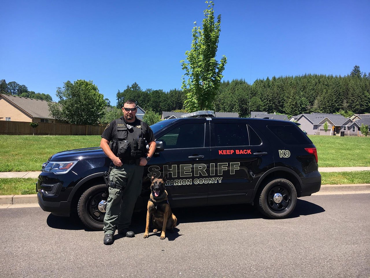 K-9 Zeke with Senior Deputy Peter Marcellais (Photo: Marion County Sheriff's Office)
