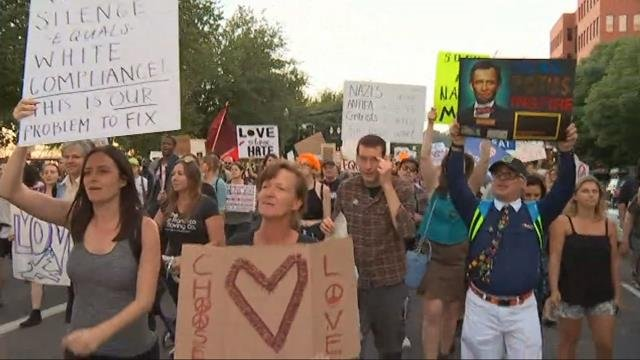 Crowds march through downtown Portland for 'Eclipse Hate' event