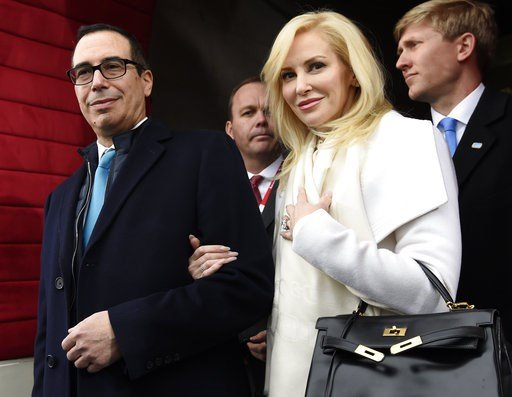 (Saul Loeb/Pool Photo via AP) In this Jan. 20, file photo, then Treasury Secretary-designate Stephen Mnuchin and his then-fiancee, Louise Linton, arrive on Capitol Hill in Washington, for the presidential inauguration of Donald Trump.
