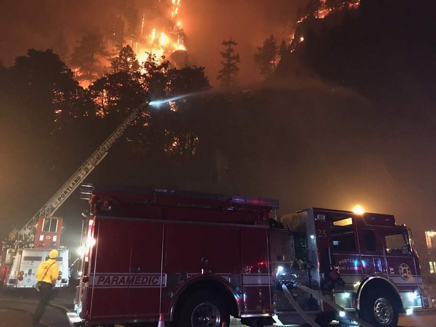 Firefighters protecting Multnomah Falls Lodge (Photo courtesy: Portland Fire & Rescue)