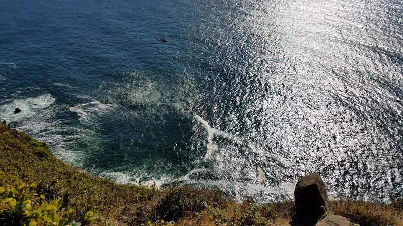 A Coast Guard helicopter searched the area of Devil's Cauldron in Oswald State Park for a man who fell off a cliff. (Photo: Oregon State Police)