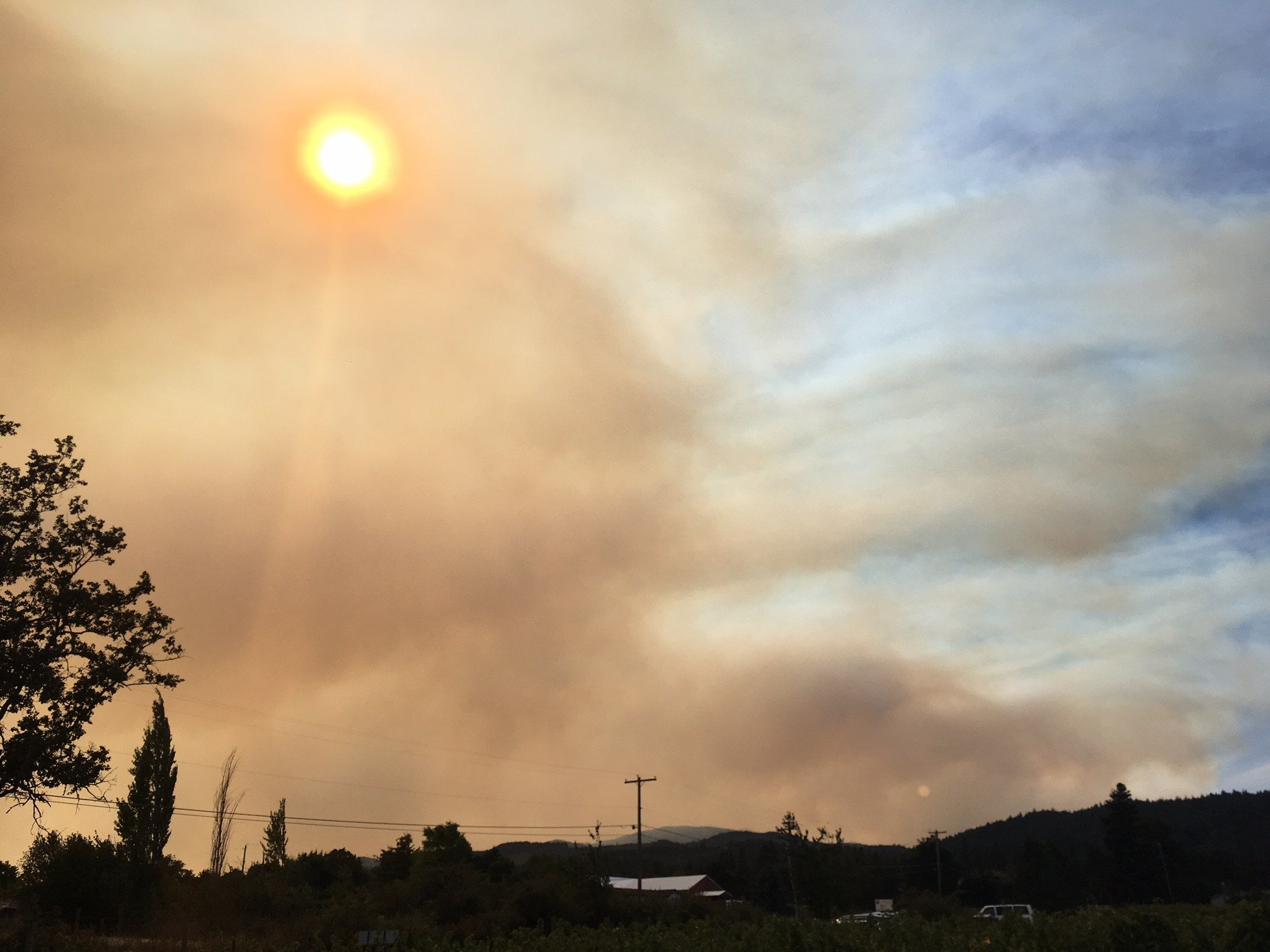 Smoke rising over the hills from the Cathedral Ridge Winery.