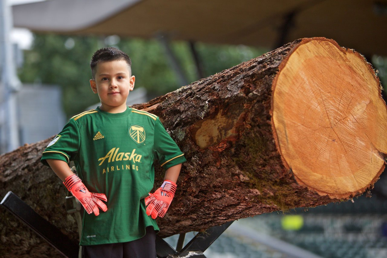 Portland Timbers goalkeeper Derrick Tellez, who signed with the club on Sept. 20 through Make-A-Wish Oregon, stands in front of the team's Victory Log at Providence Park in Portland, Ore. (Craig Mitchelldyer/Portland Timbers)