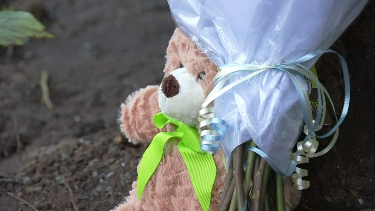 Flowers and stuffed animal left at scene of deadly crash in Vancouver. (KPTV)