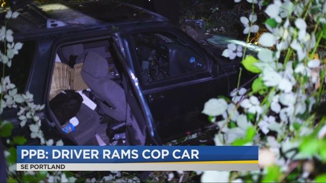 SUV hits Portland police patrol car, occupants taken into custody after search in swamp