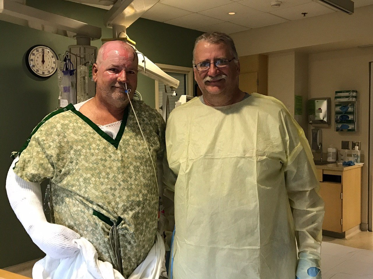 Shaw (left) with the man credited with saving his life. (KPTV)