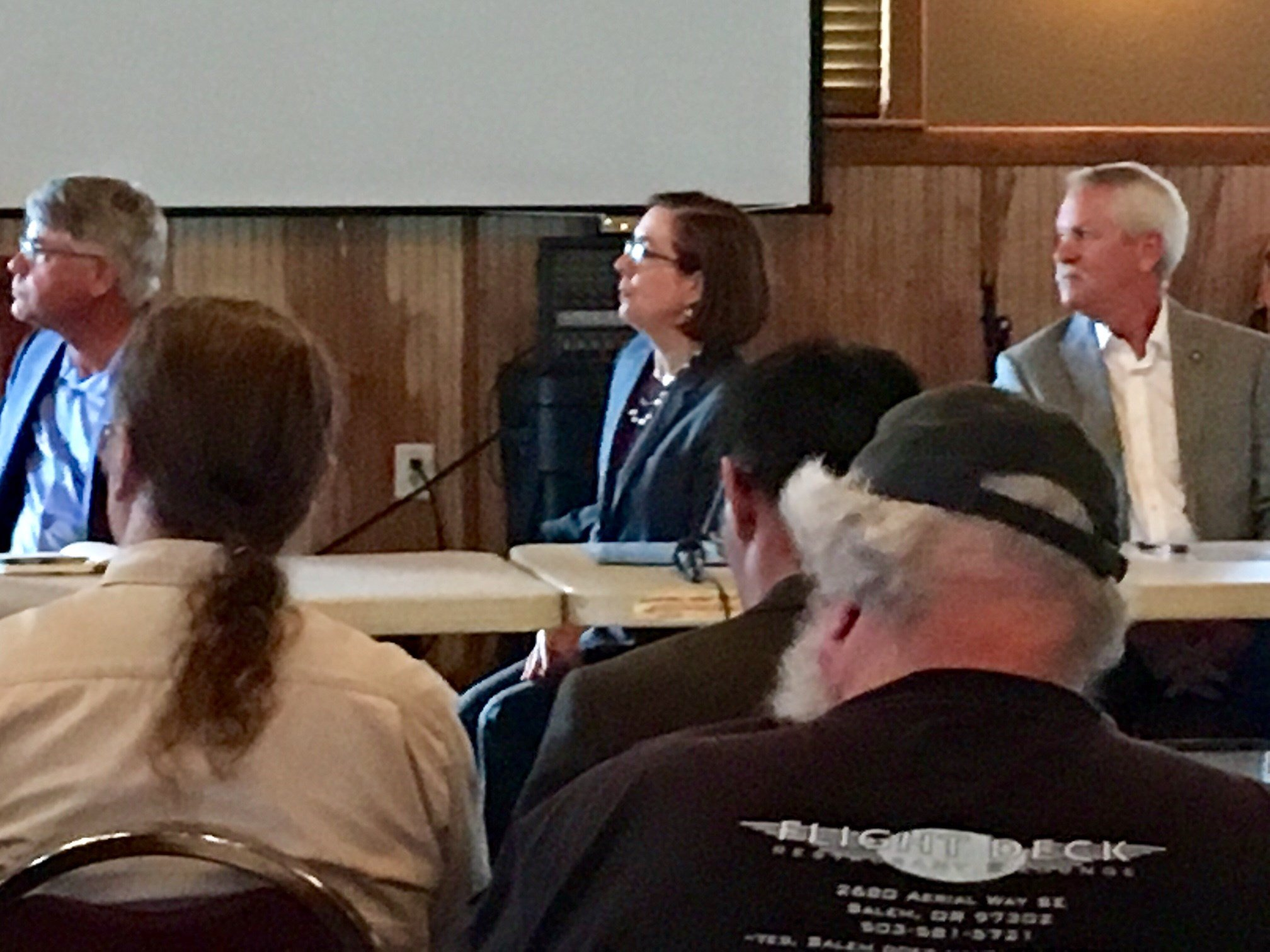 Gov. Kate Brown (center) meeting with people in Cascade Locks Friday.