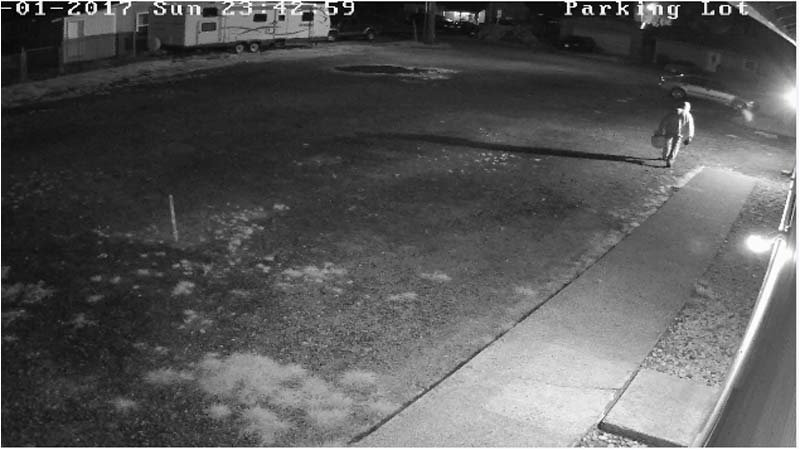 Surveillance image  released by Cowlitz County Sheriff's Office from outside the Mountain Valley Baptist Church in Kelso.