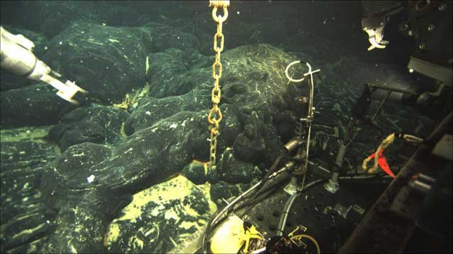Photo courtesy of OSU | An ocean-bottom hydrophone is buried in about six feet of new lava from an April 2011 eruption of Axial Seamount.