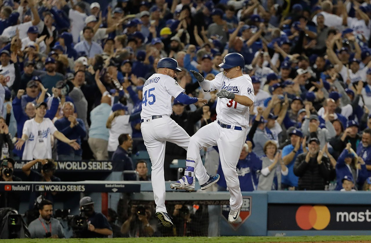 Los Angeles Dodgers' Joc Pederson celebrates his home run with third base coach Chris Woodward during the seventh inning of Game 6 of baseball's World Series against the Houston Astros Tuesday, Oct. 31, 2017, in Los Angeles. (AP Photo/David J. Phillip)