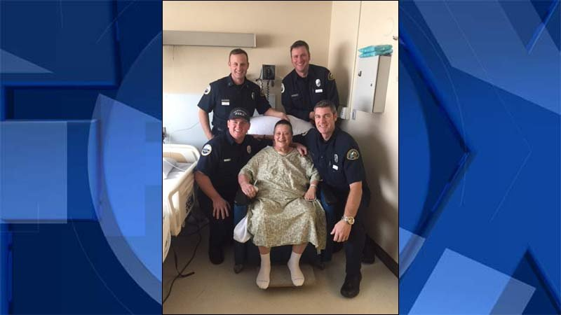 Dea Hammons at the hospital with the firefighters who saved her life. (KPTV)
