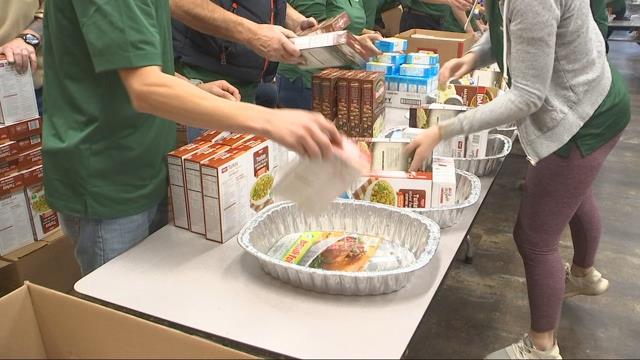 Volunteers assemble 600 Thanksgiving baskets