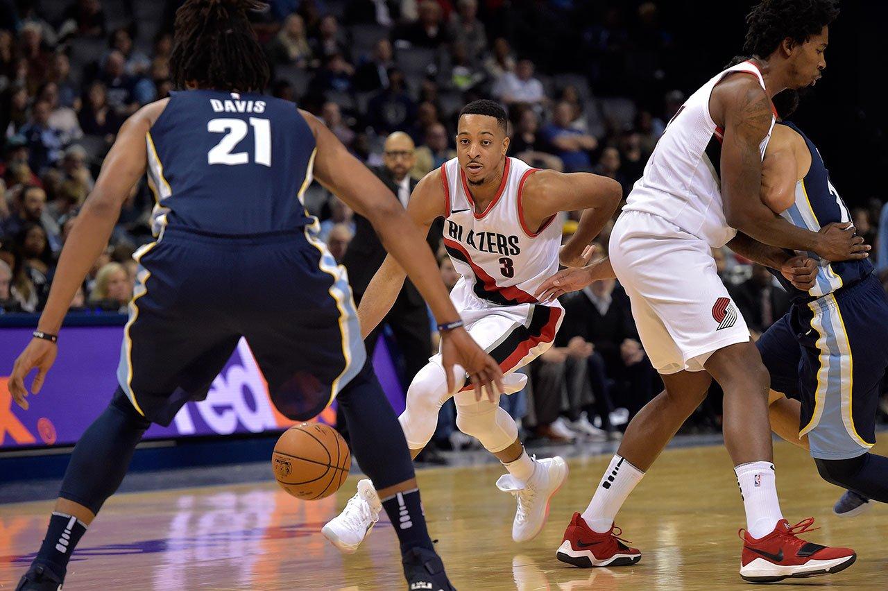 Portland Trail Blazers guard CJ McCollum (3) drives against Memphis Grizzlies center Deyonta Davis (21) in the second half of an NBA basketball game, Monday, Nov. 20, 2017, in Memphis, Tenn. (AP Photo/Brandon Dill)