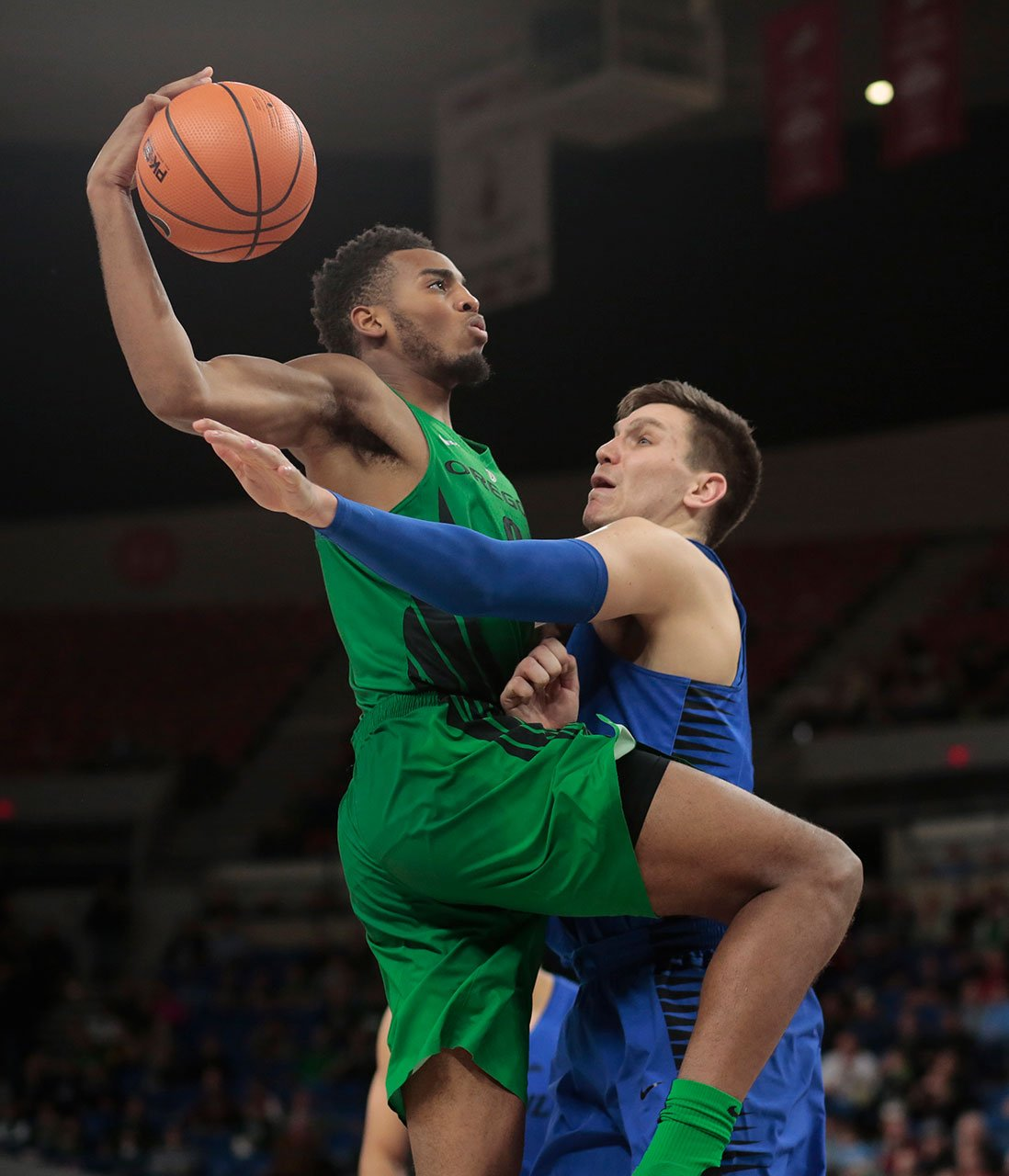 Oregon's Troy Brown tries to drive the lane while guarded by DePaul's Marin Maric in the second half of an NCAA college basketball game during the Phil Knight Invitational tournament in Portland, Ore., Friday, Nov. 24, 2017. (AP Photo/Timothy J. Gonzalez)