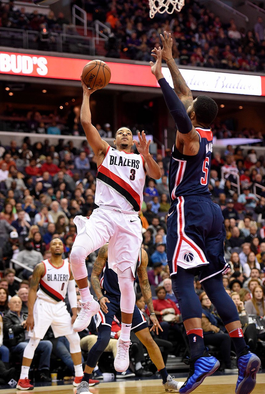 Portland Trail Blazers guard CJ McCollum (3) goes to the basket against Washington Wizards forward Markieff Morris (5) during the second half of an NBA basketball game, Saturday, Nov. 25, 2017, in Washington. The Blazers won 108-105. (AP Photo/Nick Wass)