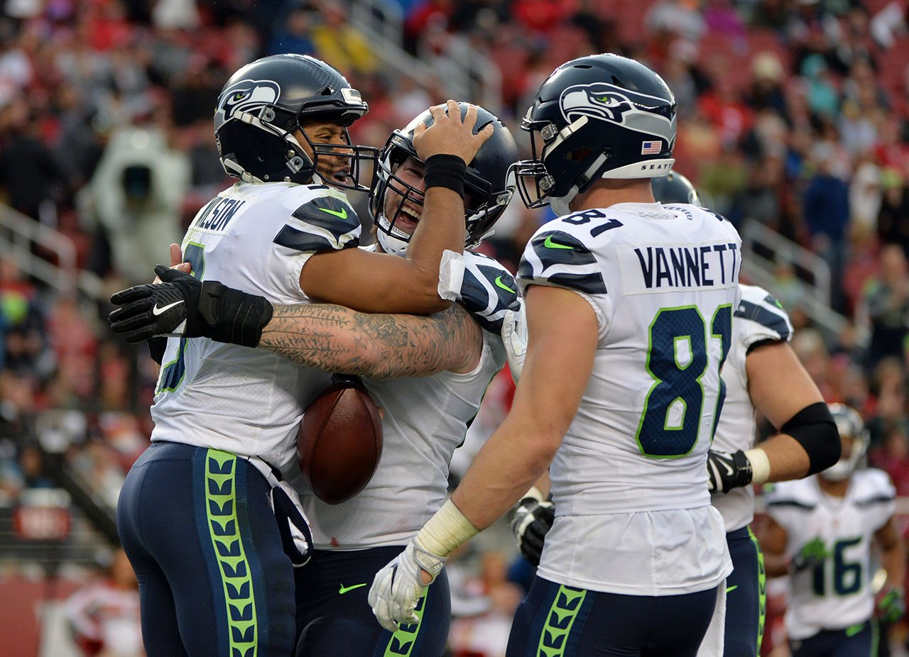 Seahawks punch the clock, beat the 49ers