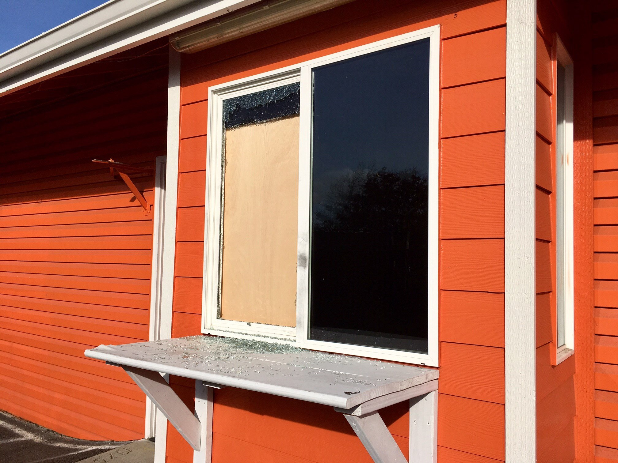 The boarded-up drive-through window. (KPTV)