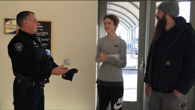 Officer Souza, Quillen Franklin & Chris Franklin at Liberty High School Tuesday. (KPTV)