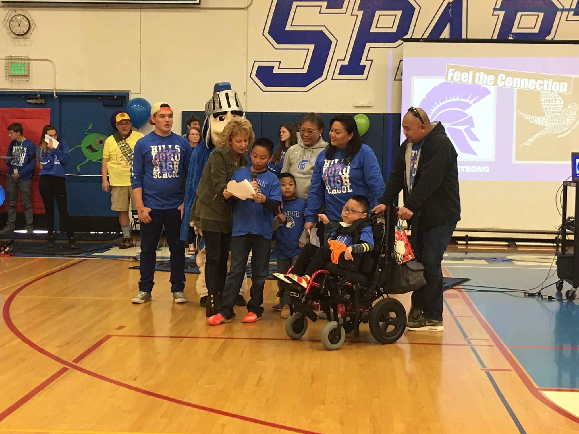 Nathan Julian surrounded by his family at Hillsboro High School Friday.