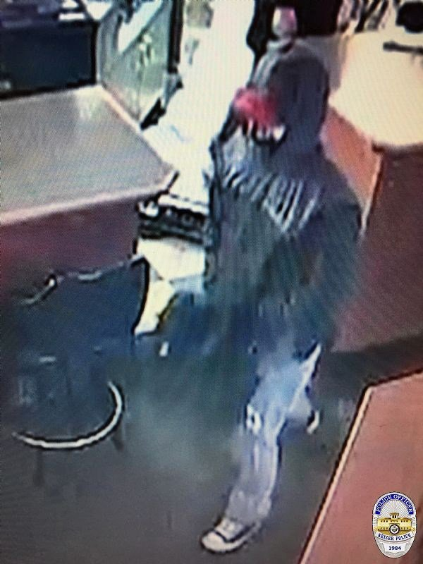 Security camera footage of the first suspect in a robbery at the Good Times Grill early in the morning of Monday, December 11, 2017. (Keizer Police Dept.)